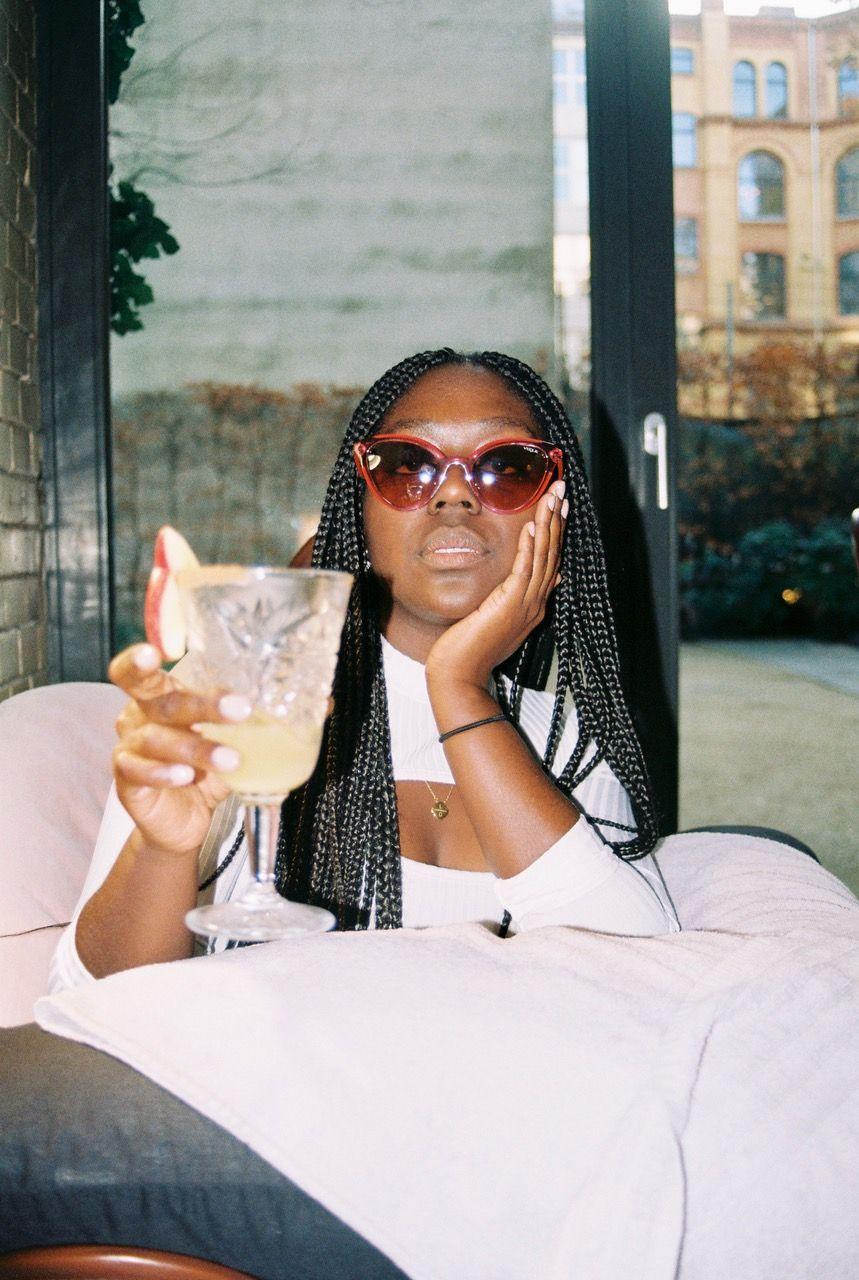 vogue eyewear lois opoku drinking cocktail