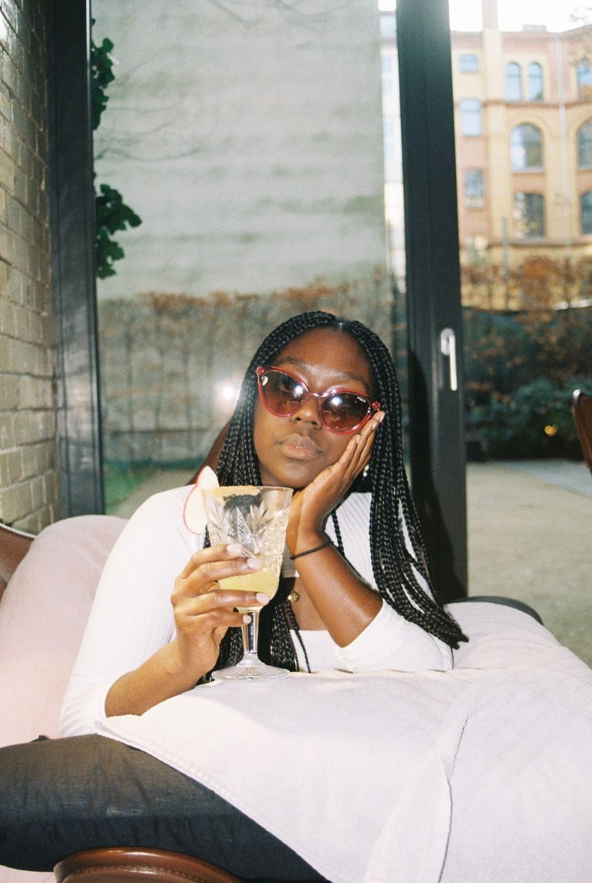 vogue eyewear lois opoku drinking cocktail sunglasses